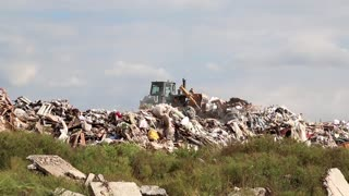 Bulldozer on landfill