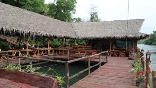 Bungalows on the Kwai river, also known as the Si Sawat river or Khwae Yai river, near Bangkok in northwestern Thailand