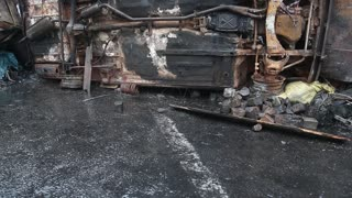 Burnt car lying on its side