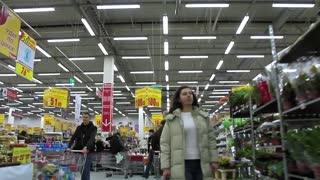 Buyers in shopping area. Customers in supermarket