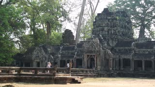 CAMBODIA, SIEM REAP, APRIL 3, 2014: People at Angkor Thom temple complex in Siem Reap, Cambodia