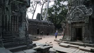 CAMBODIA, SIEM REAP, APRIL 3, 2014: People in Angkor Thom temple complex in Cambodia