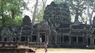 CAMBODIA, SIEM REAP, APRIL 3, 2014: People in Angkor Thom temple complex in Siem Reap, Cambodia