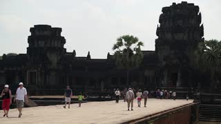 CAMBODIA, SIEM REAP, APRIL 3, 2014: People in Angkor Wat - temple complex and the largest religious monument in the world, Siem Reap province in northwestern Cambodia