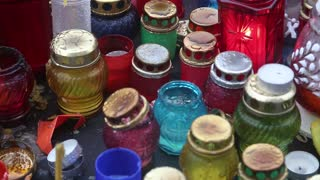 Candles inside glass many-coloured lamps