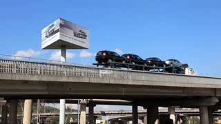 Cars go on a bridge