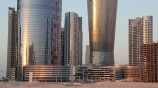 City of Lights complex at Al Reem Island in Abu Dhabi, United Arab Emirates. Abu Dhabi - capital and second most populous city in United Arab Emirates, after Dubai, also capital of Abu Dhabi emirate