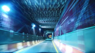 City traffic at night, the car travels through the tunnel. Cars drives through the tunnel in industrial area