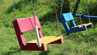Colourful swings on children playground