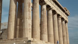 Columns of Parthenon - antique temple in Athenian Acropolis in Greece, dedicated to the goddess Athena, whom the people of Athens considered their patron