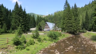 Country cottage near mountain river in Carpathian Mountains, Ukraine