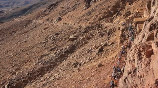 Crowd of pilgrims on Moses Mountain (Mount Sinai), Sinai peninsula, Egypt. Mount Sinai, also known as Mount Horeb, is a mountain in the Sinai Peninsula of Egypt that is the traditional and most accepted identification of the Biblical Mount Sinai.