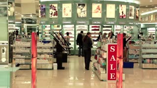 Customers in perfumers shop (little slow motion)