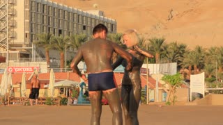 Dead Sea. Mud therapy. People on Dead Sea health resort in Israel
