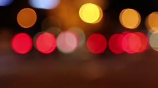 Defocused and in-focus cars in night city