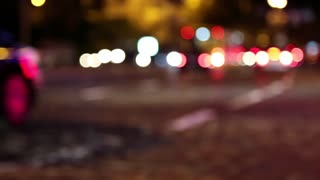 Defocused cars in night city