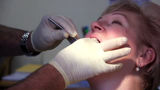 Dental patient in dentists surgery