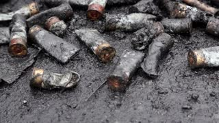 Dirty cartridge cases lying on the ground