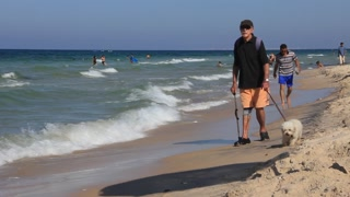 Disabled person with dog going on the beach