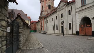 Dominican street and church of St. Nicholas or Dominican church under renovation in Kamianets-Podilskyi city, in historic region of Podolia in western Ukraine