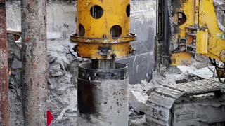 Drilling wells for bored piles