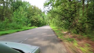 Driving on a country road. Video filming from moving car