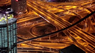 Dubai city traffic at night, United Arab Emirates. View on the Sheikh Zayed road from the 124th floor of Burj Khalifa megatall skyscraper in Dubai, currently the tallest structure in the world, 830 m