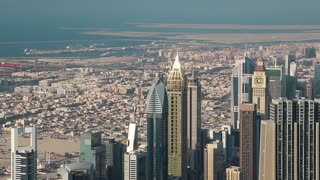 Dubai downtown and Persian Gulf, United Arab Emirates. View on skyscrapers on Sheikh Zayed road, financial district and Persian Gulf from the 124th floor of Burj Khalifa skyscraper in Dubai, UAE