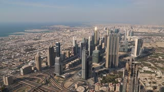 Dubai downtown and Persian Gulf, United Arab Emirates. View on skyscrapers on Sheikh Zayed road, financial district and Persian Gulf  from the 124th floor of Burj Khalifa skyscraper in Dubai