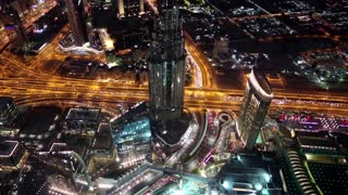 Dubai downtown at night, United Arab Emirates. Top view from the 124th floor of Burj Khalifa skyscraper, currently the tallest structure in the world, 829 m or 2,722 ft. At the top - Burj Khalifa