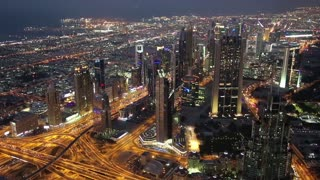 Dubai downtown at night, United Arab Emirates. Top view from the 124th floor of Burj Khalifa skyscraper in Dubai, currently the tallest structure in the world, 829,8 m. At the top - Burj Khalifa