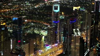 Dubai downtown at night, United Arab Emirates. View on Sheikh Zayed road from 124th floor of Burj Khalifa skyscraper in Dubai, currently tallest structure in the world, 829m. At the top - Burj Khalifa