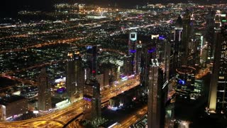 Dubai downtown at night, United Arab Emirates. View on Sheikh Zayed road from the 124th floor of Burj Khalifa skyscraper in Dubai, currently the tallest structure in the world, 829,8 m or 2,722 ft