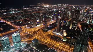 Dubai downtown at night, United Arab Emirates. View on Sheikh Zayed road from the 124th floor of Burj Khalifa skyscraper in Dubai, currently the tallest structure in the world, 829,8 m