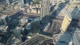 Dubai downtown, United Arab Emirates. Top view from the 124th floor of Burj Khalifa skyscraper in Dubai, currently the tallest structure in the world, 829,8 m. At the top - Burj Khalifa