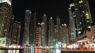 Dubai Marina night time lapse, United Arab Emirates. Dubai Marina - the largest man-made marina in the world. Dubai Marina is a canal city, carved along a 3 km stretch of Persian Gulf shoreline, UAE