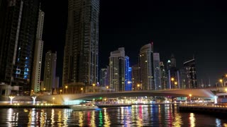 Dubai Marina night time lapse, United Arab Emirates. Dubai Marina - the largest man-made marina in the world. Dubai Marina is a canal city, carved along a 3 km stretch of Persian Gulf shoreline, UAE