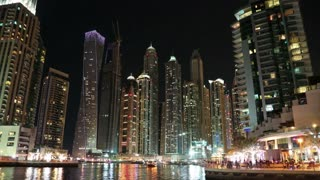Dubai Marina night zoom in timelapse, United Arab Emirates. Dubai Marina - largest man-made marina in the world. Dubai Marina - canal city, carved along a 3 km stretch of Persian Gulf shoreline, UAE