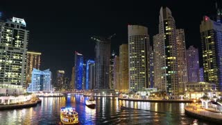 Dubai Marina night zoom in timelapse, United Arab Emirates. Dubai Marina - largest man-made marina in the world. Dubai Marina is canal city, carved along a 3 km stretch of Persian Gulf shoreline, UAE