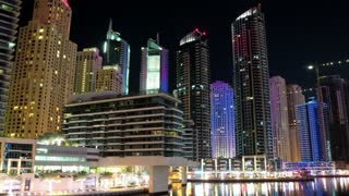 Dubai Marina night zoom out timelapse, United Arab Emirates. Dubai Marina - largest man-made marina in the world. Dubai Marina - canal city, carved along a 3 km stretch of Persian Gulf shoreline, UAE