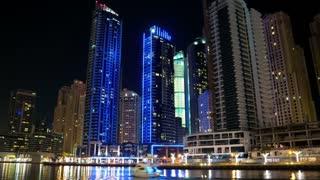 Dubai Marina night zoom out timelapse, United Arab Emirates. Dubai Marina - largest man-made marina in the world. Dubai Marina is a canal city, carved along 3 km stretch of Persian Gulf shoreline, UAE