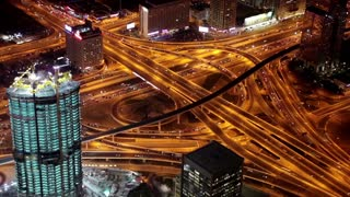 Dubai traffic at night, United Arab Emirates. View on Sheikh Zayed road from the 124th floor of Burj Khalifa skyscraper in Dubai, currently the tallest structure in the world, 829,8 m or 2,722 ft