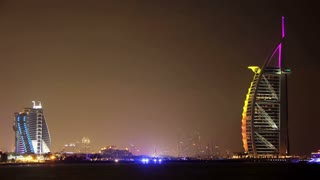 DUBAI, UAE, OCTOBER 23, 2011: 4K (4096x2304) Timelapse: Luxurious night hotels - Burj Al Arab and Jumeirah in Dubai, United Arab Emirates, October 23, 2011