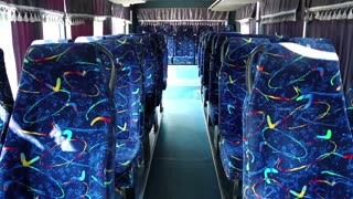 Empty interior of minibus. Bus interior with blue chair. Empty seats in bus