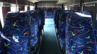 Empty seats in bus. Bus interior with blue chair. Empty interior of minibus
