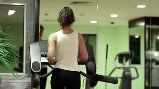 Exercising in gym, treadmill cardio workout. Woman walking on the treadmill in the gym. Woman trains in gym. Physical activity helps burn up calories. Woman goes in for sports