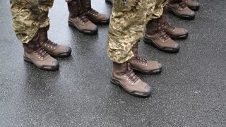 Feet of soldiers. Soldiers in military uniform. Servicemen at the military parade