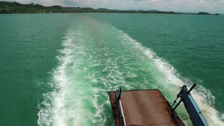 Ferry boat sails from the mainland to the Koh-Chang island, Thailand. Video with sound