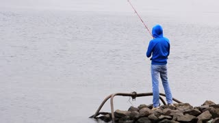 Fisherman. Boy with fishing rod on the river