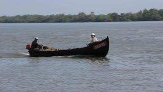 Fishermans in boat on Danube river in Vilkovo, Ukraine